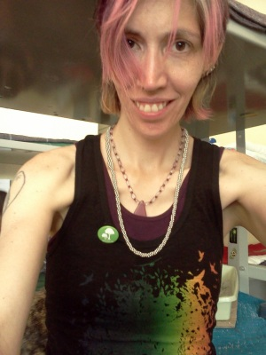 selfie of Dorian Dorey in tank top with purple hair